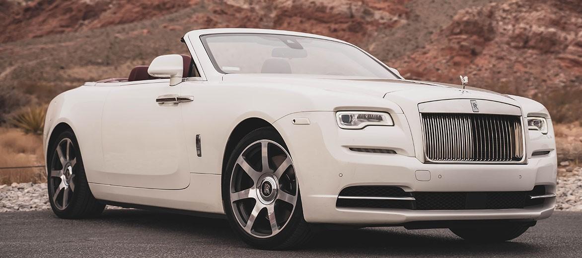 A white Rolls-Royce Dawn Convertible