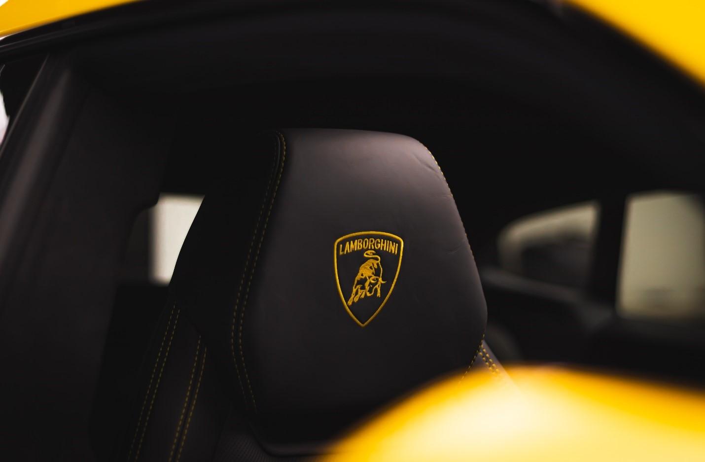 Lamborghini logo on a black car seat