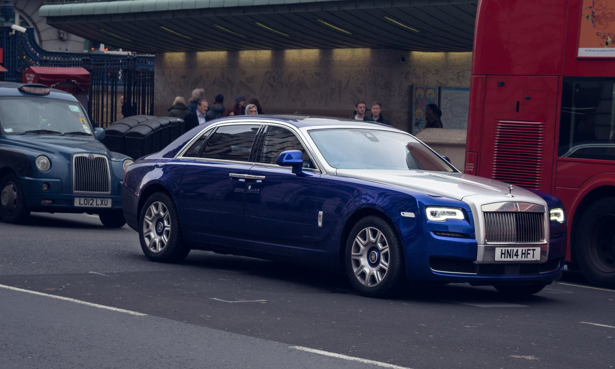 blue rolls royce parked